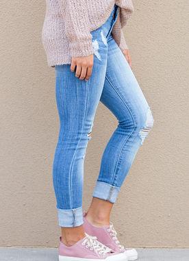 blue light wash distressed denim jeans