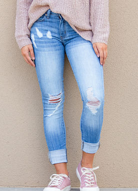 mid rise light wash distressed ripped blue jeans