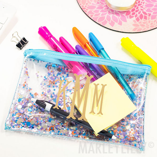 monogrammed blue floating glitter pouch