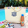 Monogrammed Pom Pom Tote Bag with accessories at the beach