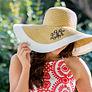 girl wearing a white stripe Monogrammed Derby Hat outside