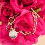 Gold Chain Bracelet on roses