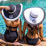 two girls wearing monogrammed beach hats