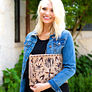 monogrammed suede mexicali clutch with jean jacket